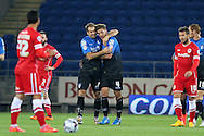 Dan Gosling of Bournemouth (centre right) celebrates after scoring his side's first goal. Capital One Cup, 3rd round match, Cardiff City v AFC Bournemouth at the Cardiff City stadium in Cardiff, South Wales on Tuesday 23rd Sept 2014<br /> pic by Mark Hawkins, Andrew Orchard sports photography.