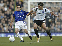Photo: Aidan Ellis.<br /> Everton v Chelsea. The FA Cup. 28/01/2006.<br /> Everton's Leon Osman battles with Chelsea's Frank Lampard