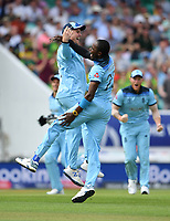 Cricket - 2019 ICC Cricket World Cup - Group Stage: England vs. South Africa<br /> <br /> England's Jofra Archer celebrates taking the wicket of South Africa's Aiden Markram with Jason Roy, at The Kia Oval.<br /> <br /> COLORSPORT/ASHLEY WESTERN