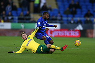 Junior Hoilett of Cardiff City is tackled by James Maddison of Norwich city (l). EFL Skybet championship match, Cardiff city v Norwich city at the Cardiff city stadium in Cardiff, South Wales on Friday 1st December 2017.<br /> pic by Andrew Orchard, Andrew Orchard sports photography.