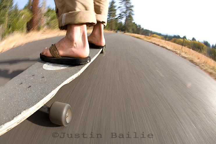 Young man skateboarding near Fallen Leaf Lake, CA.