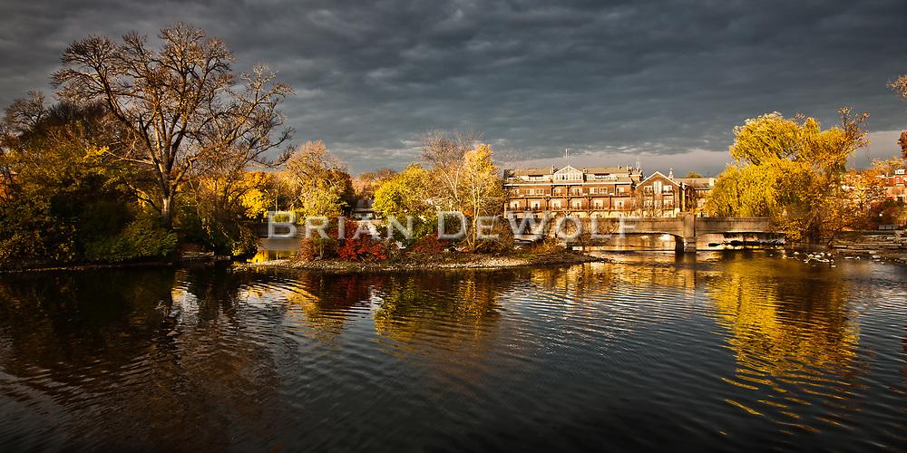 Autumn Glows as the light of dawn strikes trees along Island Park and the Herrington Inn in Geneva, Illinois.