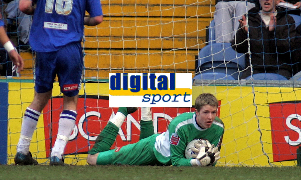 Photo: Paul Thomas.<br />Stockport County v Swindon Town. Coca Cola League 2. 03/03/2007.<br /><br />Keeper Wayne Hennessey (Ground) of Stockport keeps the clean sheet of 8 matches going by making a save.