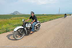 American Motordrome Wall of Death rider Danny Weil takes the back roads north of Sturgis to the Broken Spoke County Line during the Sturgis Black Hills Motorcycle Rally. SD, USA. August 4, 2014.  Photography ©2014 Michael Lichter.