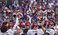 Oklahoma Sooners players huddle up prior to the game against the Kansas State Wildcats at Bill Snyder Family Stadium in Manhattan, Kansas.