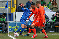 AFC Wimbledon attacker Shane McLoughlin (38) battles for possession in the corner during the The FA Cup 5th round match between AFC Wimbledon and Millwall at the Cherry Red Records Stadium, Kingston, England on 16 February 2019.