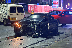 © Licensed to London News Pictures. 26/11/2020. Salford, UK. Regent Road in Ordsall is closed to traffic this evening after a road traffic accident appearing to involve three vehicles, including a black Mercedes AMG, red VW Scirroco and a white van. Photo credit: Joel Goodman/LNP