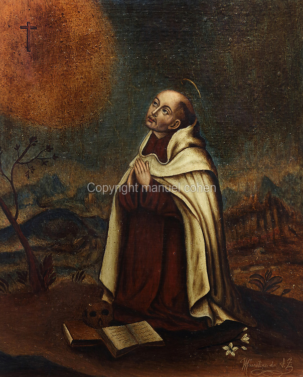 San Juan de la Cruz or St John of the Cross at prayer, oil painting on wood, 17th century, by an unknown artist, copy of the original held by the Carmelitas Delcalzos in Granada, in the Museum of St John of the Cross, or the Museo Conventual y Oratorio de San Juan de la Cruz, Ubeda, Jaen, Andalusia, Spain. St John of the Cross, 1542-91, was a Spanish mystic, Roman Catholic saint, Carmelite friar and priest and one of the Doctors of the Church. Picture by Manuel Cohen