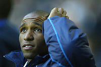 1/1/2005 - FA Barclays Premiership - Tottenham Hotspur v Everton - White Hart Lane<br />Tottenham Hotspur's Jermain Defoe scratches his head as he sits out the game injured<br />Photo:Jed Leicester/Back Page Images