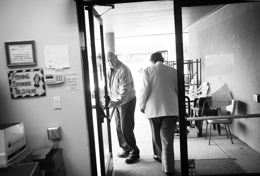 Ivan Mahoney leads his wife, Dot, out of the center after the caretaker class. While their caretakers learn new ways of coping in a class at South Salem Senior Center, people with Alzheimer's Disease make new friends on Saturday, Oct. 23, 2010.
