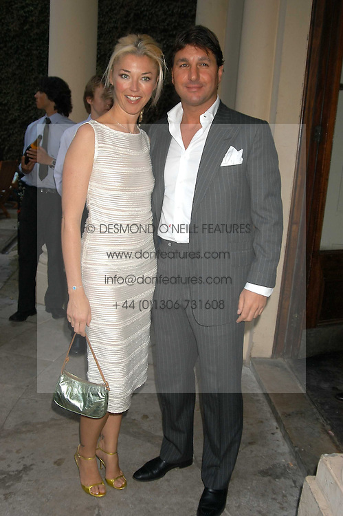 MISS TAMARA BECKWITH and MR GEORGE VERONI at the Tatler Summer Party in association with Moschino at Home House, 20 Portman Square, London W1 on 29th June 2005.<br /><br />NON EXCLUSIVE - WORLD RIGHTS