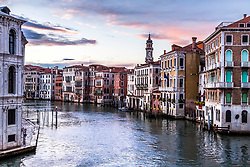 Sunrise over Venice Italy. Shortly before this vibrant and busy city comes to life in the morning, peaceful moments can be eluded to between supply boats delivering goods to local businesses.