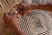 Macushi people &weaving split vine<br /> Yupukari village<br /> Savannah, Rupununi<br /> GUYANA<br /> South America