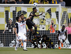 May 9, 2018 - Columbus, OH, USA - Columbus Crew SC defender Harrison Afful, top, heads the ball against Philadelphia Union midfielder Ilsinho at MAPFRE Stadium in Columbus, Ohio, on Wednesday, May 9, 2018. (Credit Image: © Kyle Robertson/TNS via ZUMA Wire)