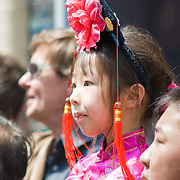 Young girl watching Chinese New Year parade