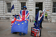 Anti Brexit protester and campaigner Steve Bray wearing European and Union flags outside the Cabinet Office in Westminster as inside the Tory Cabinet meets to discuss Brexit on 16th August 2019 in London, England, United Kingdom.