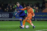 AFC Wimbledon striker Joe Pigott (39) battles for possession with Doncaster Rovers goalkeeper Seny Dieng (24) during the The FA Cup match between AFC Wimbledon and Doncaster Rovers at the Cherry Red Records Stadium, Kingston, England on 9 November 2019.