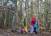 Laura Marsh, a mother who lost her teenage son in an accident four months earlier, right, embraces Bryan Plecan, a friend of the victims at the scene of the crash where four teens were killed in a single-vehicle accident in Griswold, Conn. (AP Photo/Jessica Hill)