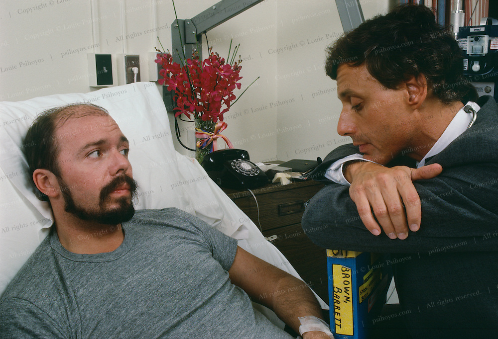 AIDS patient Barrett Brown with lover Dennis in Cabrini Hospital, New York City, 1985.