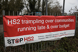 Harefield, UK. 3 February, 2020. An anti-HS2 banner fixed to a fence by campaign group Stop HS2.