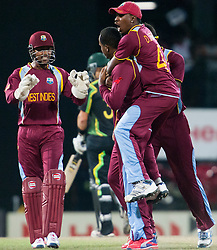 © Licensed to London News Pictures. 05/10/2012. West Indians team celebrate after getting out Mike Hussey during the World T20 Cricket Mens Semi Final match between Australia Vs West Indies at the R Premadasa International Cricket Stadium, Colombo. Photo credit : Asanka Brendon Ratnayake/LNP