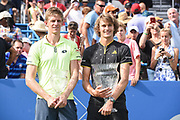 KEVIN ANDERSON and ALEXANDER ZVEREV hold their trophy's after the men's singles final at the Citi Open at the Rock Creek Park Tennis Center in Washington, D.C. Zverev beat Anderson 6-4, 6-4.