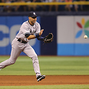 New York Yankees shortstop Derek Jeter (2) is seen making a play at second base during a major league baseball game between the New York Yankees and the Tampa Bay Rays at Tropicana Field on Thursday, Sept. 17, 2014 in St. Petersburg, Florida. The Yankees won the game 3-2 and this was Jeter's last game against Tampa Bay. (AP Photo/Alex Menendez)