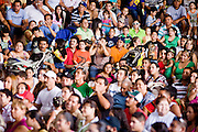 July 13, 2008 -- PHOENIX, AZ: The crowd at a Lucha Libre show at El Gran Mercado in Phoenix. Lucha Libre is Mexican style wrestling. There are heros (Tecnicos) and villians (Rudos). The masks are popular as children's gifts and tourist mementos. As the size of the Mexican community in the Phoenix area has grown, attendance at the Lucha Libre shows has increased. Lucha Libre differs from American style entertainment wrestling in several ways, but principally the wrestlers are more acrobatic and rely less on body slams than American wrestling. The shows, which used to be held only periodically, are now held every week at El Gran Mercado, a flea market and swap meet that caters mostly to the Mexican community in Phoenix.   Photo by Jack Kurtz / ZUMA Press