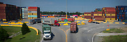 Top lifts work on loading and unloading shipping containers at the Mason Intermodal yard in Garden City, Ga., Wednesday, July 11, 2018. (GPA Photo/Stephen B. Morton)