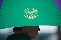 LONDON, ENGLAND - Tuesday, June 28, 2016: A Wimbledon branded umbrella during the Ladies' Singles 1st Round match on day two of the Wimbledon Lawn Tennis Championships at the All England Lawn Tennis and Croquet Club. (Pic by Kirsten Holst/Propaganda)