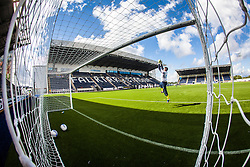 Falkirk FC keeper Michael McGovern seen through the goal net during the warm-up. The Falkirk Stadium, with the new pitch work for the Scottish Championship game v Morton. The woven GreenFields MX synthetic turf and the surface has been specifically designed for football with 50mm tufts compared with the longer 65mm which has been used for mixed football and rugby uses.  It is fully FFA two star compliant and conforms to rules laid out by the SPL and SFL.<br /> ©Michael Schofield.