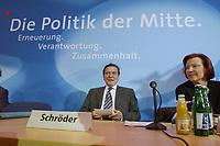 """13 MAY 2002, BERLIN/GERMANY:<br /> Gerhard Schroeder, SPD, Bundeskanzler, unter dem Schriftzug """"Die Politik der Mitte"""", vor Beginn der SPD Parteikonferenz, links: Heidemarie Wieczorek-Zeul, Bundesentwicklungshilfeministerin, Willi-Brandt-Haus<br /> IMAGE: 20020513-03-005<br /> KEYWORDS: Gerhard Schröder"""