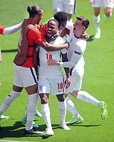 Football - 2021 EUFA European Championships - Finals - Group D - England vs Croatia, Wembley Stadium<br /> <br /> Raheem Sterling of England celebrates scoring his goal with Mson Mount and other team mates<br /> <br /> Credit : COLORSPORT/Andrew Cowie