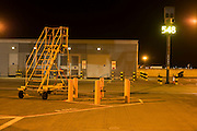 Overnight landscape of airfield movement area (apron)  equipment at Heathrow Airport's Terminal 5.
