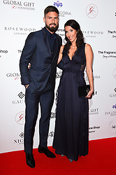 Olivier Giroud and Jennifer Giroud attending the 9th Annual Global Gift Gala held at the Rosewood Hotel, London. Picture date: Friday November 2nd 2018. Photo credit should read: Matt Crossick/ EMPICS Entertainment.