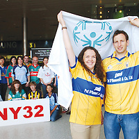 2 August 2007; Members of the Team NY 32, Liz Walsh, and Kieran Kennedy, before departing from Dublin Airport to paticpate in the New York City Half Marathon. Team NY 32, which is made up of representatives from every county in Ireland are on their way to the New York City Half Marathon to help raise funds to recruit more athletes into the Special Olympics programme around the country. Wearing the 32 county jerseys, sponsored by O'Neill's Sports, Azzuri & Gaelic Gear, the team will participate in the 13mile (almost 22kms) run through the streets of the 'Big Apple' in under three hours on Sunday the 5th August 2007.  Dublin Airport, Dublin. Picture credit: Brian Lawless / SPORTSFILE *** NO REPRODUCTION FEE ***