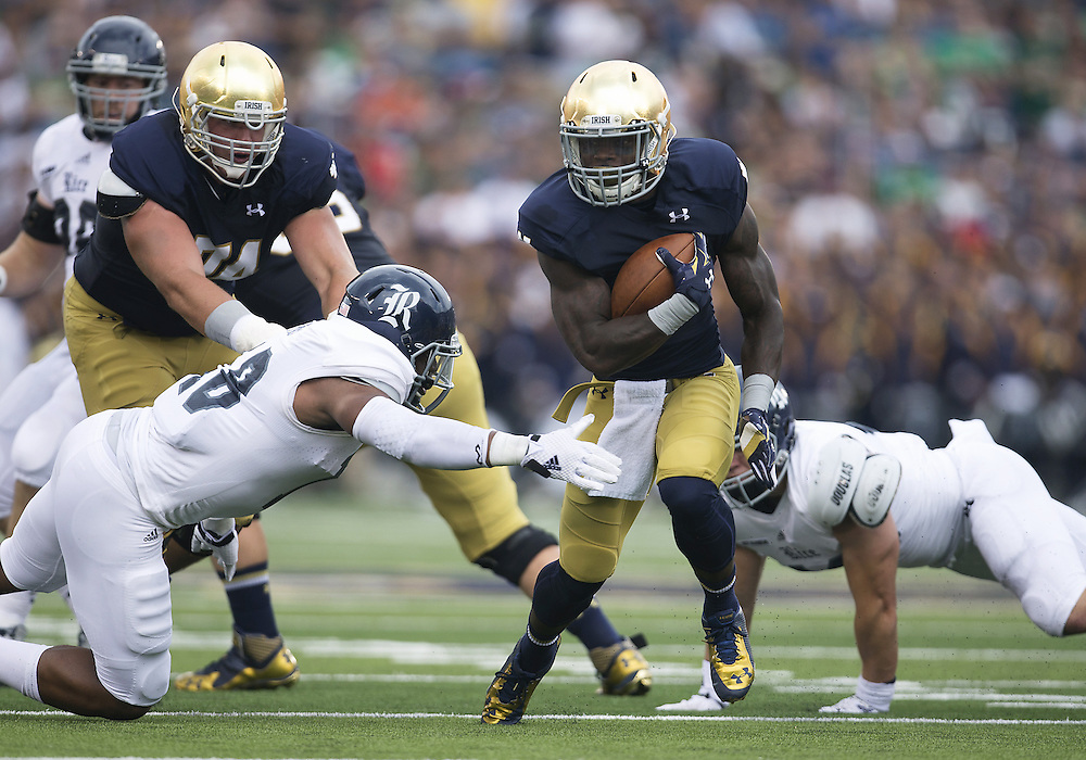 August 30, 2014:  Notre Dame running back Greg Bryant (1) runs for yardage during NCAA Football game action between the Notre Dame Fighting Irish and the Rice Owls at Notre Dame Stadium in South Bend, Indiana.  Notre Dame defeated Rice 48-17.