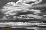 Lenticular clouds and the McGillycuddy Reeks at Inch Beach in County Kerry, Ireland