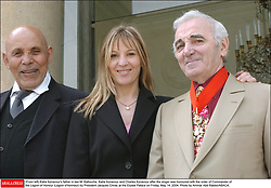 (From left) Katia Aznavour's father in law M. Kallouche, Katia Aznavour and Charles Aznavour after the singer was honoured with the order of Commander of the Legion of Honour (Legion d'Honneur) by President Jacques Chirac at the Elysee Palace on Friday, May 14, 2004. Photo by Ammar Abd Rabbo/ABACA.