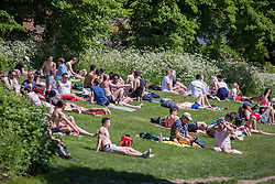 © Licensed to London News Pictures. 30/05/2021. London, UK. Public enjoy the sunny weather during bank holiday in Hampstead Heath, north London.  Photo credit: Marcin Nowak/LNP