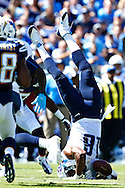 NASHVILLE, TN - SEPTEMBER 22:  Kenny Britt #18 of  the Tennessee Titans lands on his head after trying to make a catch during a game against the San Diego Chargers at LP Field on September 22, 2013 in Nashville, Tennessee.  (Photo by Wesley Hitt/Getty Images) *** Local Caption *** Kenny Britt Sports photography by Wesley Hitt photography with images from the NFL, NCAA and Arkansas Razorbacks.  Hitt photography in based in Fayetteville, Arkansas where he shoots Commercial Photography, Editorial Photography, Advertising Photography, Stock Photography and People Photography