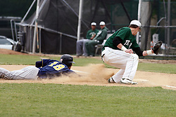 28 April 2012:  Baserunner Jacob VanDuyne slides back to the bag guarded by first baseman Bobby Czarnowski during an NCAA division 3 Baseball game between the Augustana Vikings and the Illinois Wesleyan Titans in Jack Horenberger Stadium, Bloomington IL