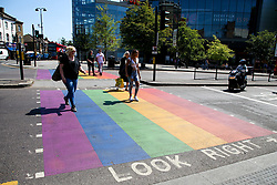 © Licensed to London News Pictures. 23/06/2020. London, UK. Members of the public walking on a Rainbow crossing on Wood Green High Road in north London. Rainbow crossings symbolise the diversity and pride of the LGBTQ community. Photo credit: Dinendra Haria/LNP