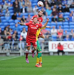 Cardiff City's John Brayford wins a high ball. - Photo mandatory by-line: Alex James/JMP - Mobile: 07966 386802 30/08/2014 - SPORT - FOOTBALL - Cardiff - Cardiff City stadium - Cardiff City  v Norwich City - Barclays Premier League