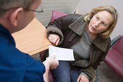 Authorised Nurse handing prescription to patient; NHS Walkin Centre Nottingham,