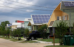 29 May 2014. New Orleans, Louisiana.<br /> Brad Pitt's Make it Right foundation architect inspired, eco friendly homes in the Lower 9th Ward. <br /> Charlie Varley/varleypix.com