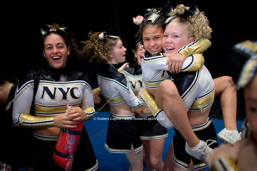 Ashley Lavan jumps into teammate Amanda Murphy's arms after her team, the The NY Cheer Jr. Gold, won the championship for their class during the NCA/NDA U.S. Championship held at the Hammerstein Ballroom Sat. March 10, 2007. Rising popularity in the sport of cheerleading has brought a significant increase in cheerleading related accidents and injuries.
