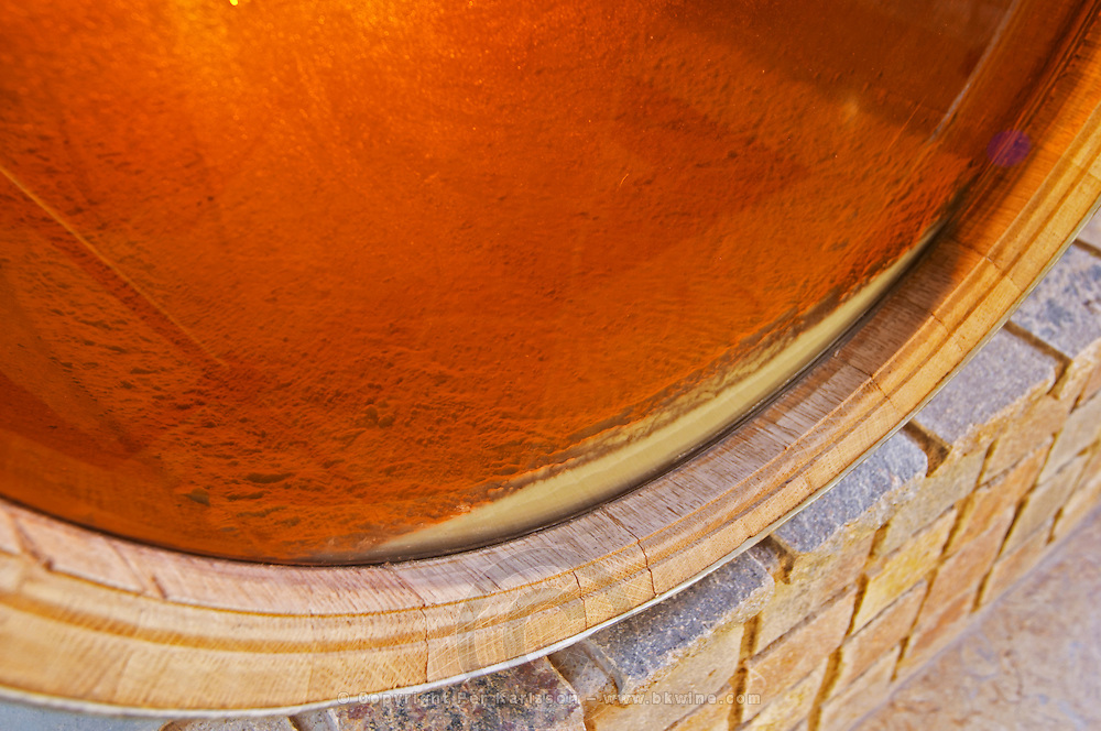Detail of a barrel with wine where one of the sides has been replaced by Plexiglas so that you can see the deposit in the barrel, dead yeast cells fall down to the bottom of the barrel. Bodega Familia Schroeder Winery, also called Saurus, Neuquen, Patagonia, Argentina, South America