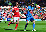 Chris Dagnell shields the ball from Jack Barthram during the Sky Bet League 1 match between Swindon Town and Leyton Orient at the County Ground, Swindon, England on 3 May 2015. Photo by Alan Franklin.