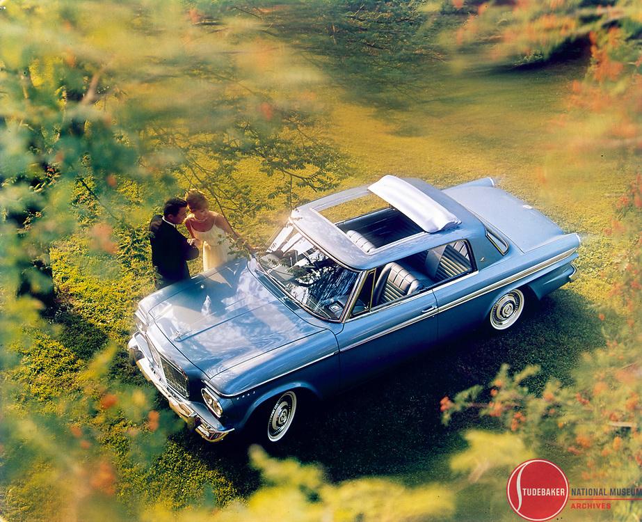 Promotional image for 1963 Studebaker Lark Daytona hardtop with Skytop sunroof.